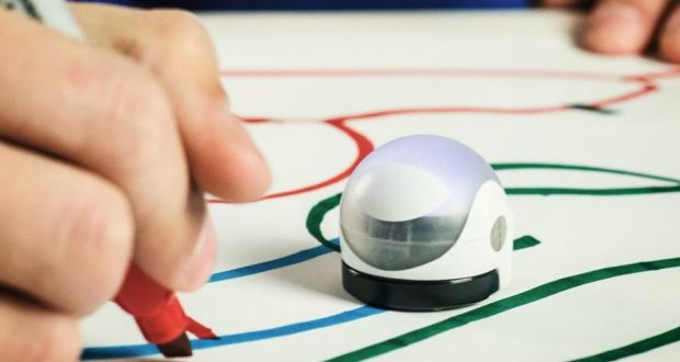 A student playing with an Ozobot